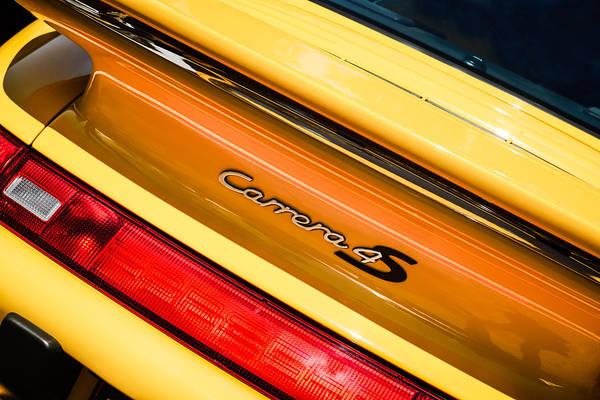 Photograph - Porsche Carrera 4s Taillight Emblem -0205c by Jill Reger