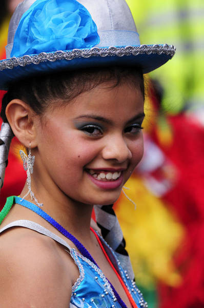 Wall Art - Photograph - Portrait Of A Girl At The Carnaval Del Pueblo In London by Liz Pinchen