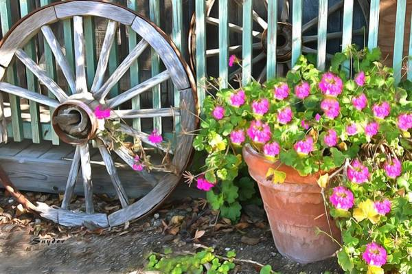 Photograph - Potted Plant And A Wagon Wheel by Floyd Snyder