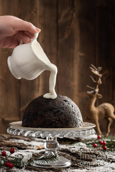 Pouring Photograph - Pouring Cream Over Christmas Pudding by Amanda Elwell