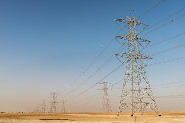 Photograph - Power Poles And High-voltage Lines In The Desert by Alexandre Rotenberg