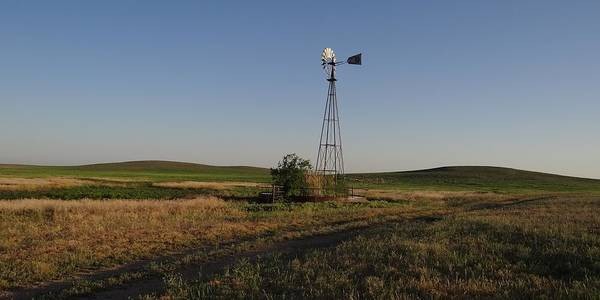 Photograph - Prairie Windmill At Sunset by Keith Stokes