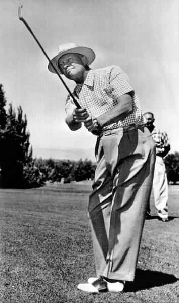Warming Up Wall Art - Photograph - President Eisenhower Golfing by Underwood Archives