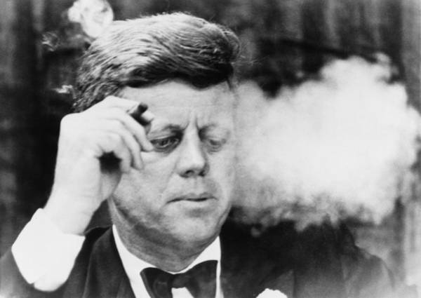 Raising Wall Art - Photograph - President John Kennedy, Smoking A Small by Everett