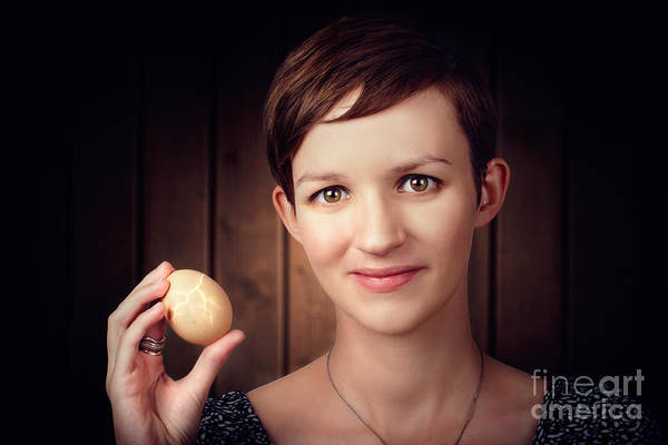 Egg Shell Photograph - Pretty Young Brunette Woman Holding Hatching Egg by Jorgo Photography - Wall Art Gallery