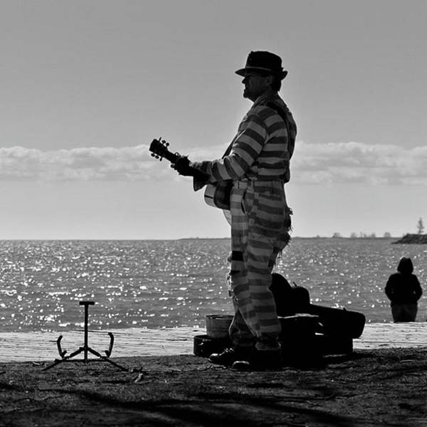Musicians Wall Art - Photograph - Prison Break Blues.  Busking On The by Brian Carson