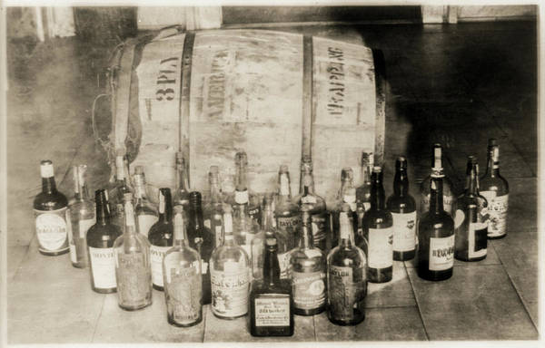 Photograph - Prohibition Bottles And Barrel Of Confiscated Whiskey by Digital Reproductions