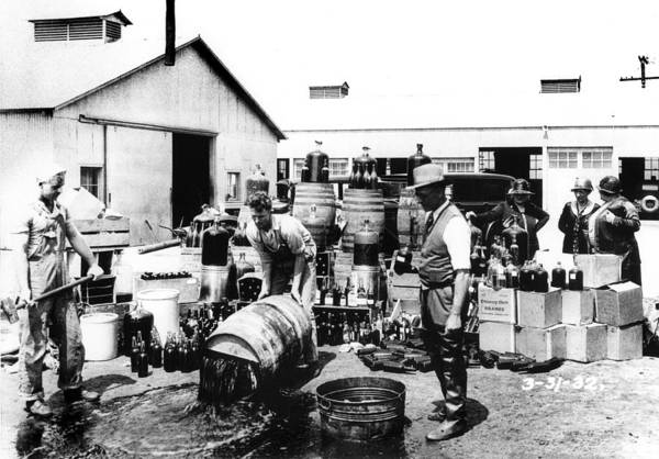 Photograph - Prohibition - Dumping The Alcohol by Bill Cannon