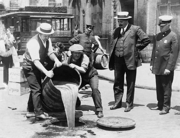Down The Drain Wall Art - Photograph - Prohibition - Pouring Beer Down The Drain by Bill Cannon