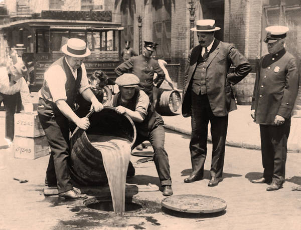 Photograph - Prohibition - Pouring Beer Down The Drain In Sepia by Bill Cannon
