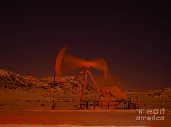 Wall Art - Photograph - Pumpjack In Motion At Night by Jeff Swan