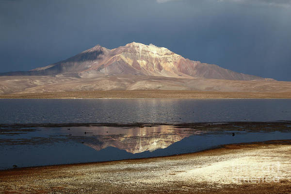 Photograph - Quisi Quisini Volcano And Lake Chungara On A Stormy Afternoon Chile by James Brunker