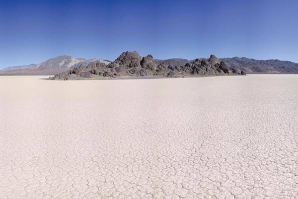 Racetrack Playa Photograph - Racetrack Playa And The Grandstand Death Valley by Brian Lockett
