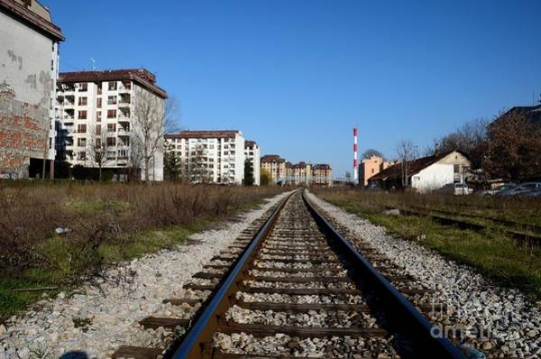 Photograph - Railway Tracks Weathered Apartment Buildings And Red Industrial Chimney Belgrade Serbia by Imran Ahmed