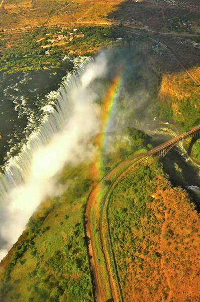 Photograph - Rainbow Over Victoria Falls by Don Mercer