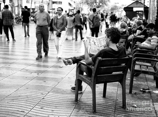 Photograph - Reading A Newspaper On La Rambla Barcelona by John Rizzuto