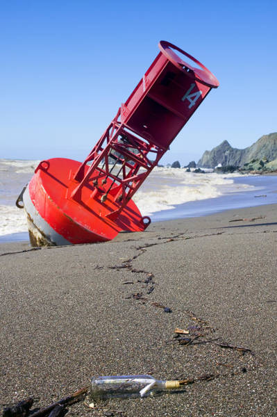 Bell Photograph - Red Bell Buoy On Beach With Bottle by Garry Gay