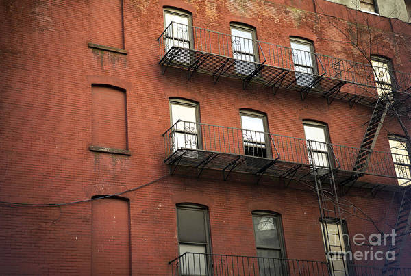Photograph - Red Brick In The City by John Rizzuto