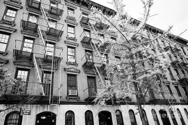 Wall Art - Photograph - red brick low rise apartment blocks with external fire escapes greenwich village New York City USA by Joe Fox