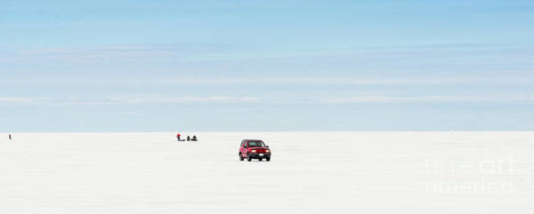 Photograph - Red Car Driving On A Frozen Lake Simcoe by Les Palenik
