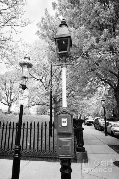 Wall Art - Photograph - red fire alarm call box and old red tinted gas street light downtown Boston USA by Joe Fox