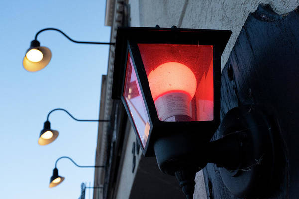 Red Light On The Wall With A Blue Sky And Yellow Bulbs In Holland Michigan Art Print