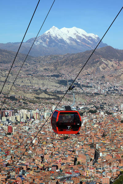 Photograph - Red Line Cable Car Cabin And Mt Illimani Bolivia by James Brunker