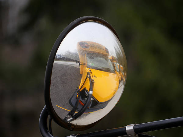 Photograph - Reflecting On A School Bus by Richard Reeve