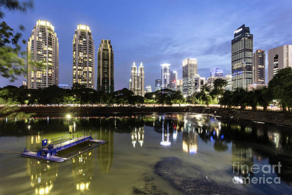 Photograph - Reflection Of Jakarta Business District Skyline During Blue Hour by Didier Marti