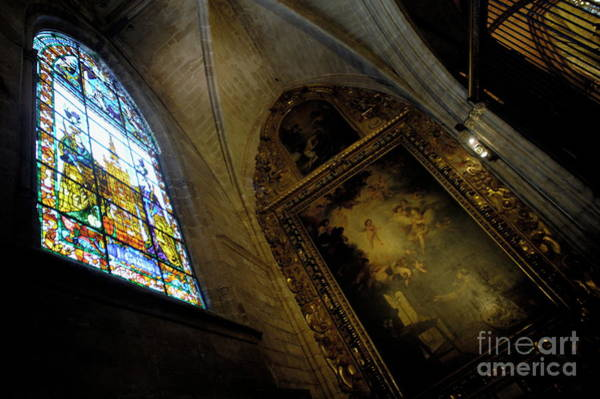 Wall Art - Photograph - Religious Painting And Stained Glass Window Inside A Chapel At The Seville Cathedral by Sami Sarkis
