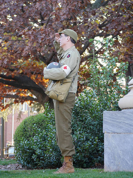 Photograph - Remembrance - A Medic Salutes The Flag by Richard Reeve