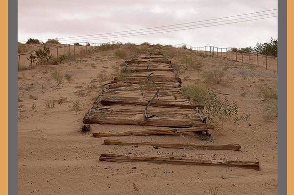 Photograph - Remnants Of Old Plank Road  Algodones Dunes Photo By Perdelsky  Number Seven Imperial County Ca 2007 by David Lee Guss