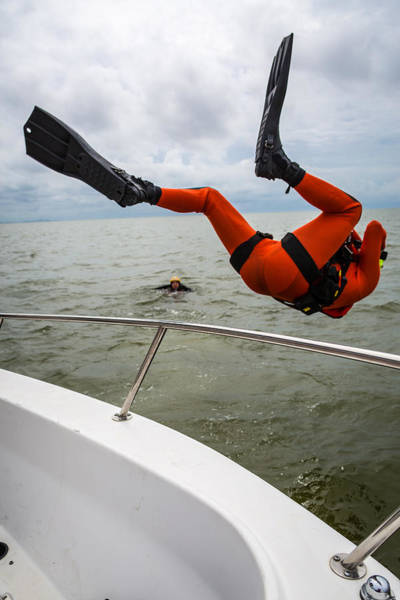Photograph - Rescue Swimmer Overboard by Gregory Daley  MPSA