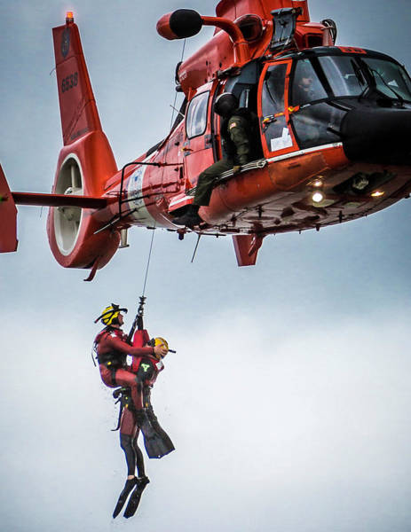 Photograph - Rescuer And Victim In Hoist by Gregory Daley  MPSA