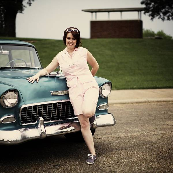 Wall Art - Photograph - Retro Woman Leaning On Hood Of Car by Gillham Studios