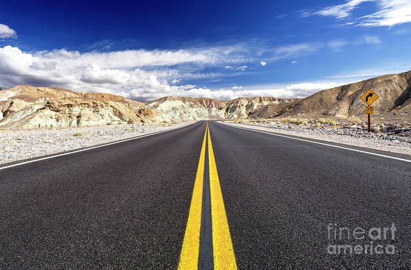 Photograph - Riding Down The Highway At Death Valley by John Rizzuto