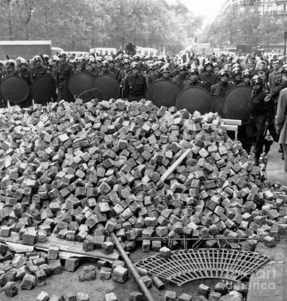 Wall Art - Photograph - Riot Squad Behind Cobblestone Thrown By Demonstrators, Paris, May 11, 1968 by French School