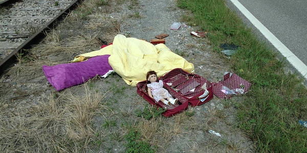 Photograph - Roadside Doll by Steve Sperry