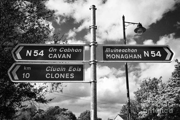 Gaelic Photograph - roadsigns for the N64 between monaghan and cavan and clones county monaghan republic of ireland by Joe Fox