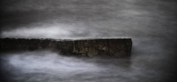 Water Erosion Photograph - Rock And The Sea by Nigel Jones