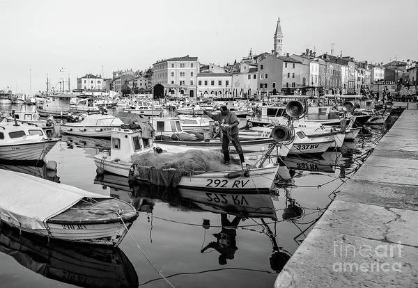 Photograph - Rovinj Fisherman Working In Old Town Harbor - Rovinj, Istria, Croatia by Global Light Photography - Nicole Leffer