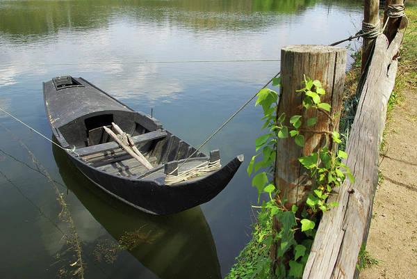 Wall Art - Photograph - Row Boat On The Shoreline by Carlos Caetano