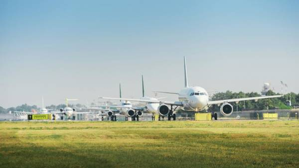Photograph - Row Of Airplanes Ready To Take-off by Alexandre Rotenberg