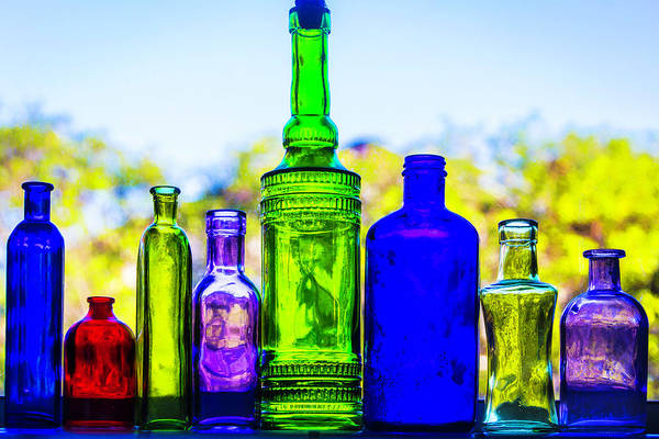 Wall Art - Photograph - Row Of Colored Bottles by Garry Gay
