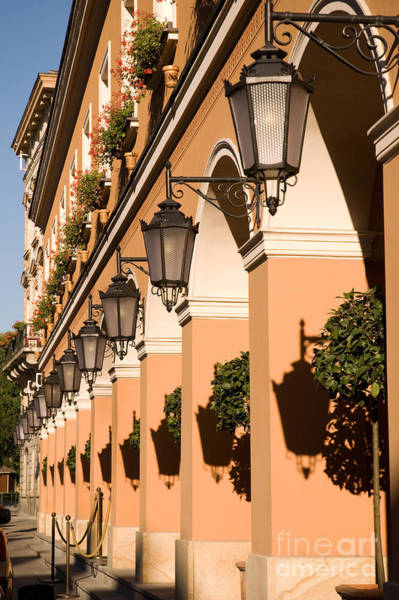 Wall Art - Photograph - Row Of Lamps On Columns Of Building  by Arletta Cwalina