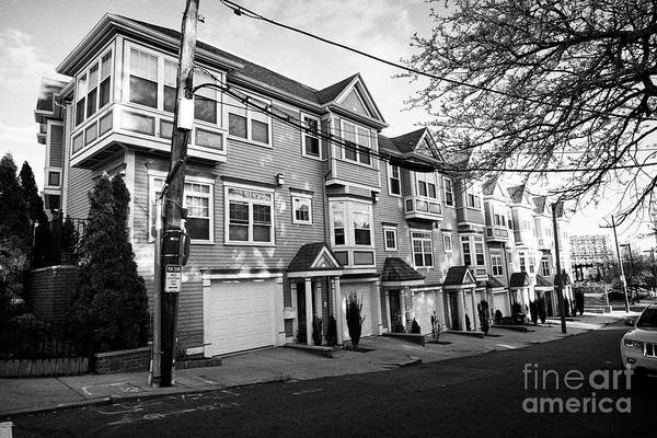 Wall Art - Photograph - row of three storey townhouses with garages on south sydney street savin hill flats Boston USA by Joe Fox