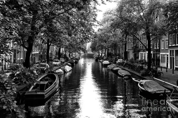 Photograph - Rowboat On The Canal Mono by John Rizzuto