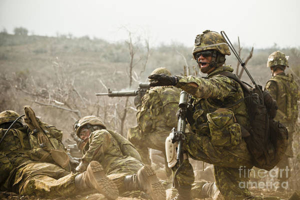 Battleground Photograph - Royal Canadian Army Officer Directs by Stocktrek Images