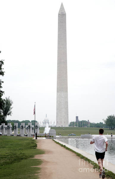 Photograph - Running Past The Reflecting Pool Towards The Washington Monument by William Kuta