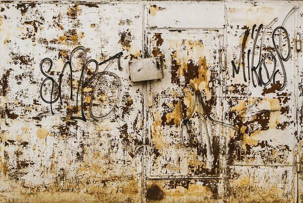 Photograph - Rust On Grey Metal With Urban Vandal Art by John Williams